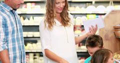 Young family shopping in grocery store Stock Footage