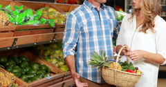 Happy couple shopping in grocery store Stock Footage