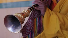 Musician plays horn at the masked dance Festival, detail,Lamayuru,Ladakh,India Stock Footage