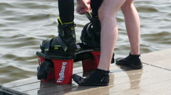 Flyboard boots being secured Stock Footage