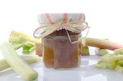 Rhubarb jam jar with fresh rhubarb - stock photo