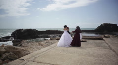 Couple poses for wedding photos, muslim woman photographs Stock Footage