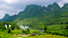 Ban Gioc Waterfall in lush green valley with rice fields. Vietnam. - stock footage