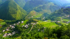 View of valley with green rice terraces and village. Sapa, Vietnam Stock Footage