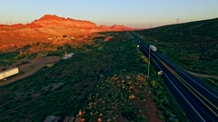 Highway in Painted desert valley at sunset Stock Footage