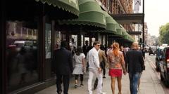 People walking outside Harrods, London Stock Footage