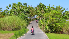 Motorbikes and cars on nature path Stock Footage