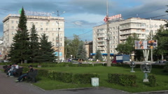 People sit at Theatre Square around the monument to the brothers Cherepanov Stock Footage