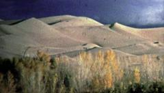 1972: Great Sand Dunes National Park showcases glowing sand. Stock Footage
