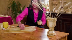 Vase with wheat and woman choosing straws 4K Stock Footage