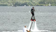 Man trying flyboard Stock Footage