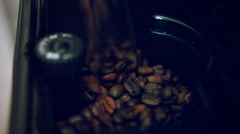 Putting some coffee beans in the coffee machine Stock Footage