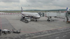 Aircraft of Aeroflot Airlines company stands near jet bridge Stock Footage