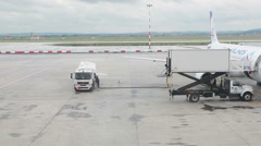 Tank truck aircraft refueler is on apron for refueling airliner of Ural Airlines Stock Footage