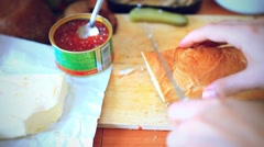 Hand chef doing sandwiches with red caviar and butter on a wooden board Stock Footage