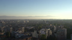 Pan over city in sunrise Sofia Bulgary Stock Footage