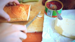 Hand chef doing Sandwiches with red caviar served on wood cutting board over old Stock Footage