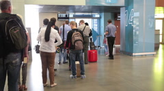 Passengers pass gate counter in queue before aircraft boarding. Yekaterinburg Stock Footage