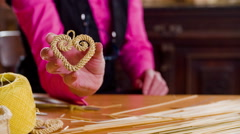 Showing heart shaped crafted decoration from straws 4K Stock Footage