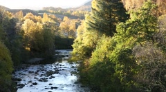 Autumn colours on River Fechlin, Scottish Highlands, Scotland - stock footage