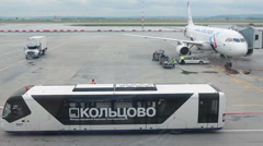 People mover a odd-looking bus stands on apron ready for passengers. Russia - stock footage