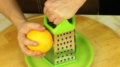 Men's hands make orange zest Stock Footage