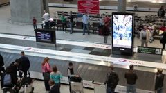 Typical baggage claim area with baggage carousels is in arriving lounge Stock Footage