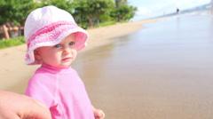 Cute blonde toddler standing in the ocean - stock footage