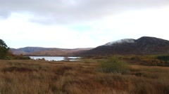 Low cloud and mist over Scottish loch Stock Footage
