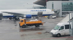 The Boeing-76 aircraft of Transaero Airlines is on parking place at apron Stock Footage