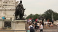 Visitors in front of Buckingham Palace, London HD Footage