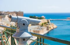 telescope for viewing city attractions - stock photo