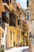 typical narrow street in Valletta - stock photo