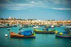 fishing boats near village of Marsaxlokk - stock photo