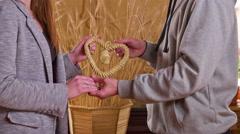 Couple hold handmade heart from straws 4K Stock Footage