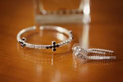 Earrings and bracelet with crystals - stock photo