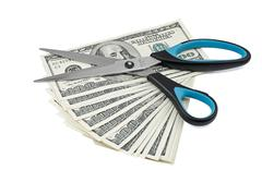 Batch of dollars and scissors Stock Photos