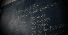 Blackboard with cross fit training plan Stock Footage