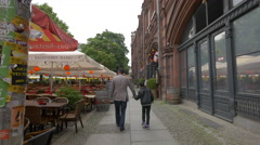 Father and son walking on Neue Promenade in Berlin Stock Footage