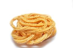 Traditional Indian Diwali snacks Chakali Stock Photos