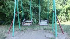 Empty swing in park Stock Footage