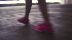 Feet with sneakers walking on concrete floor Stock Footage
