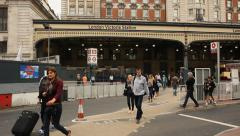 People walking in front of Victoria station, London Stock Footage