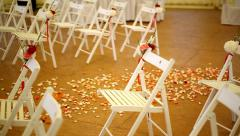 Rows of white wooden chairs at wedding ceremony Stock Footage