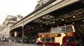 Sightseeing bus under Victoria Station, London Footage