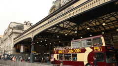 Sightseeing bus under Victoria Station, London Stock Footage