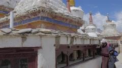 Man spins prayer wheel around gompa,Lamayuru,Ladakh,India Stock Footage