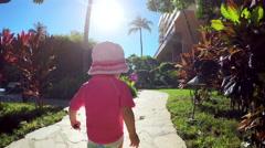 Cute toddler walking toward a resort pool Stock Footage
