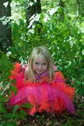 Little girl in fairy costume in the forest - stock photo