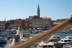Old city of Rovinj seen through the fishing net - stock photo